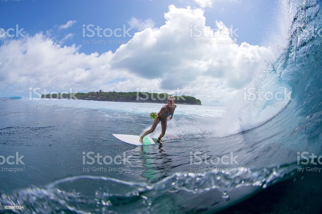 Surfer girl announces pregnancy with baby on board sign stock photo
