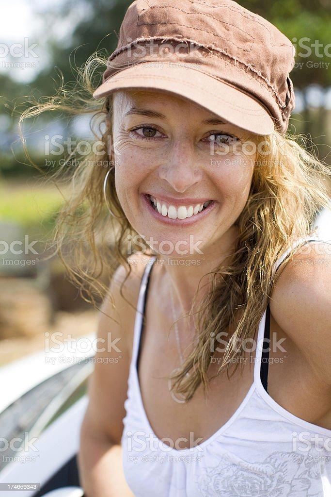 surfer girl at beach stock photo