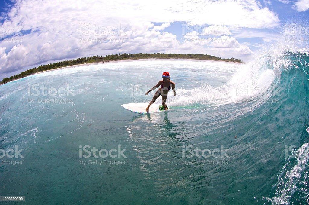 Surfer girl at Christmastime stock photo