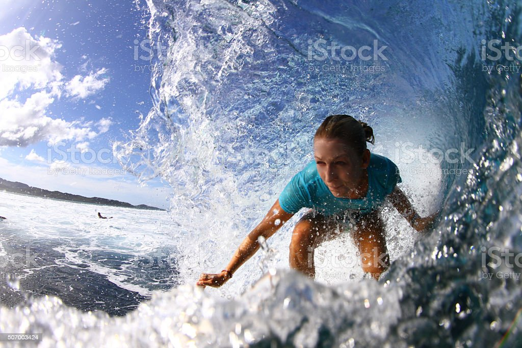 Surfer girl gets barreled stock photo