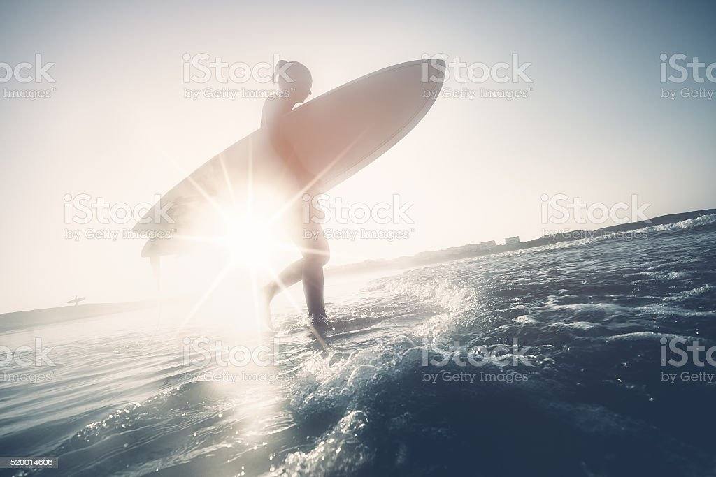 Surfer girl silhouette stock photo