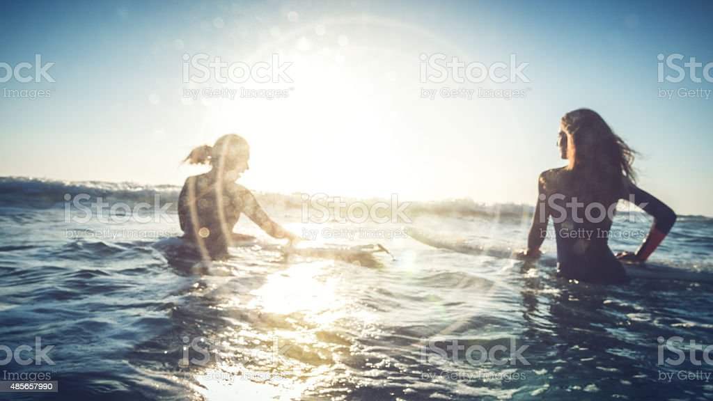 Surfer girls in action stock photo