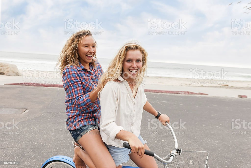 Surfer Girls On A Bike royalty-free stock photo
