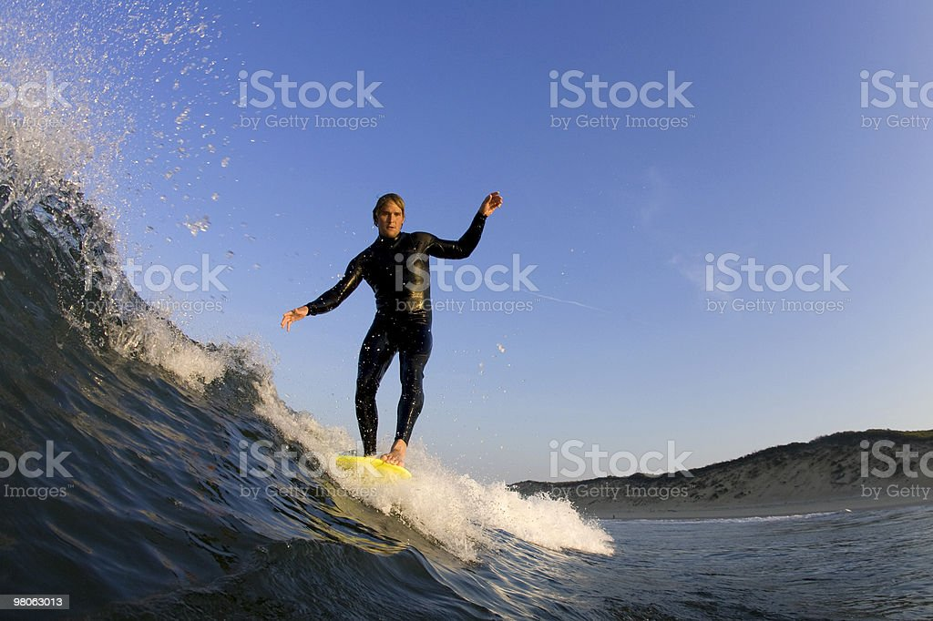 Surfer hanging 5 on a longboard stock photo