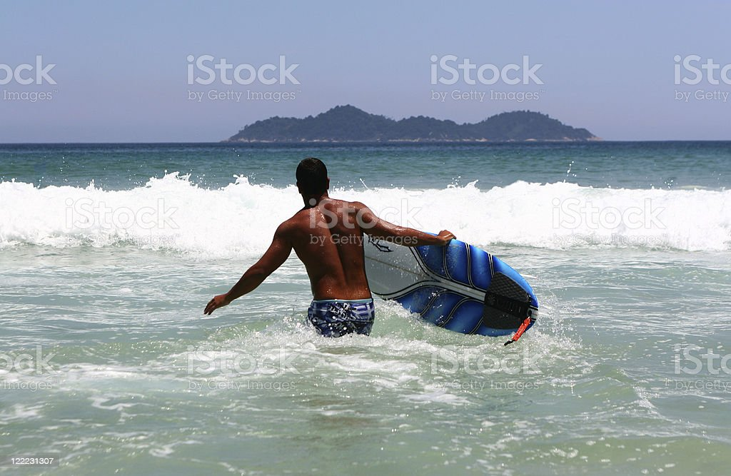 Surfer Heading Out to Sea royalty-free stock photo