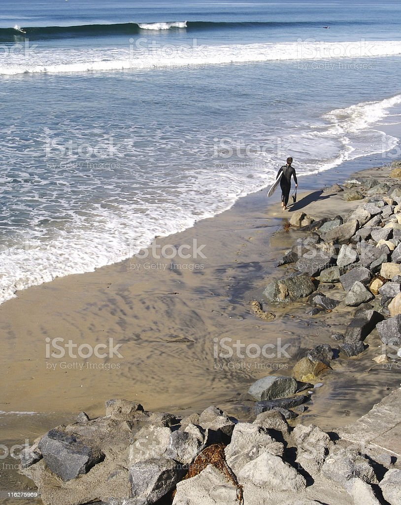 Surfer Heading Out to the Waves stock photo