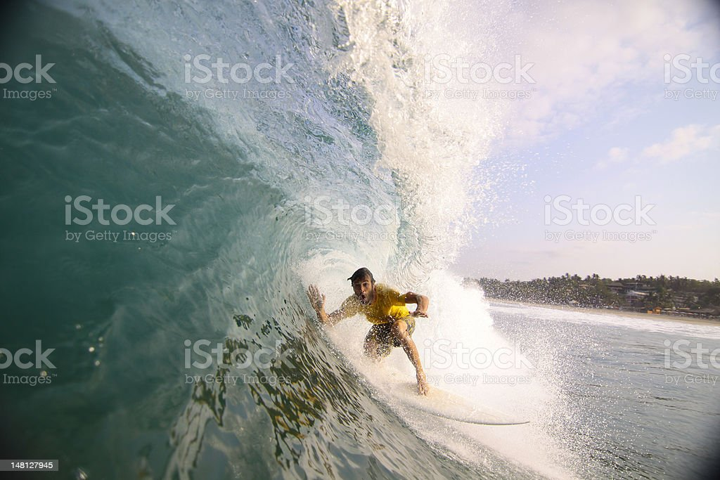 Surfer in a blue water barrel. stock photo