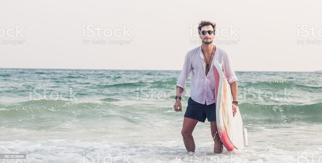 Surfer in his paradise stock photo