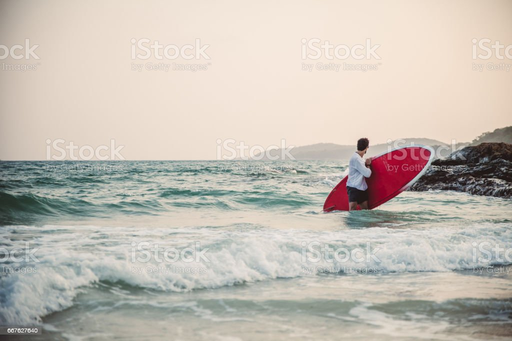 Surfer in the water stock photo