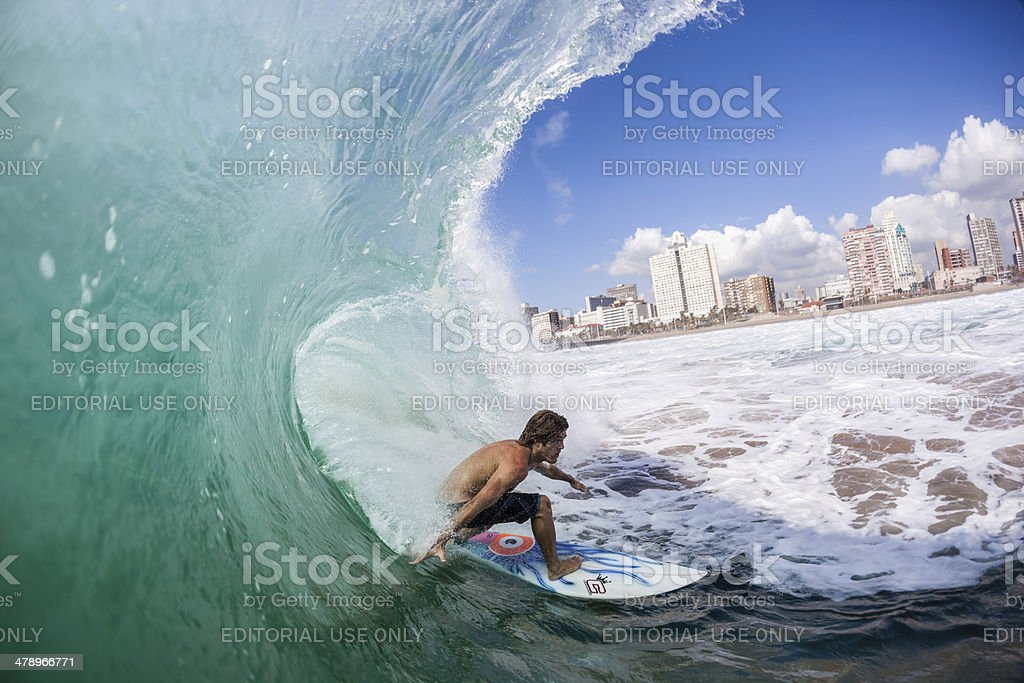 Surfer Inside Hollow Wave stock photo