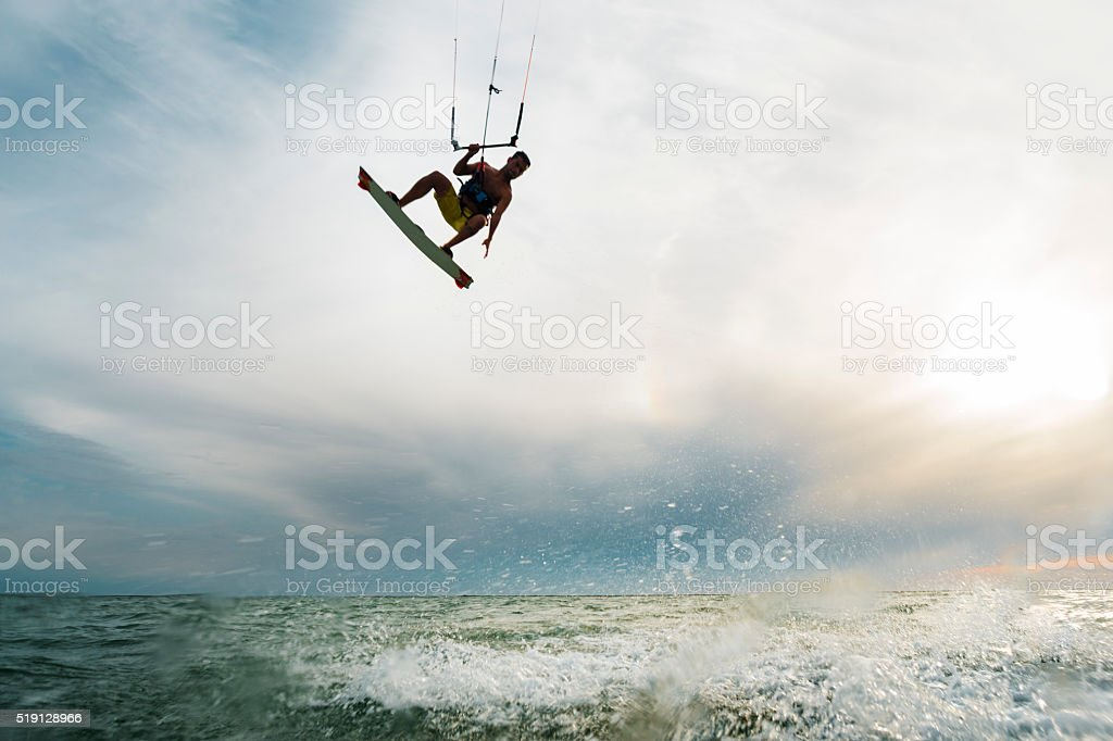 Surfer jumping over the water stock photo