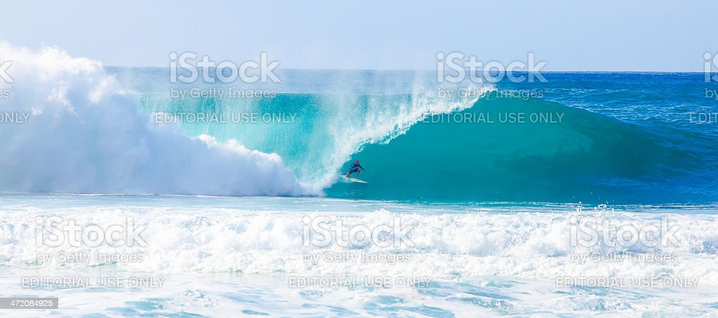 Surfer Kelly Slater Surfing Bonzai Pipeline in Hawaii stock photo