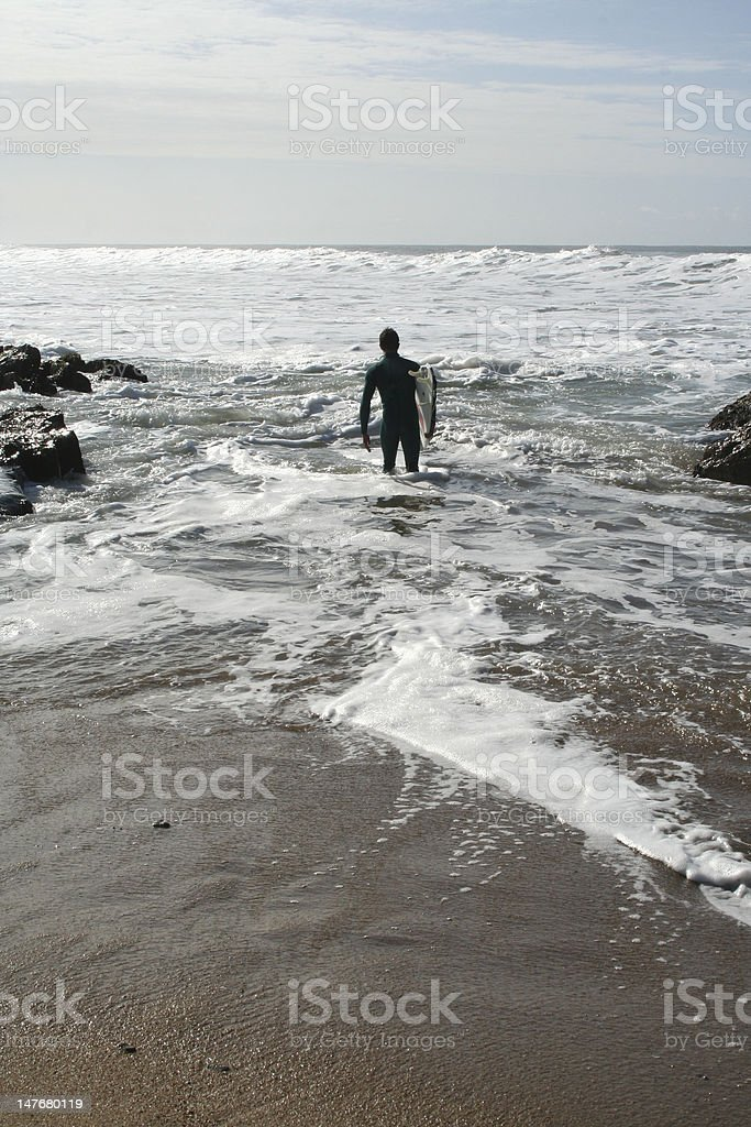 surfer looking at the sea royalty-free stock photo