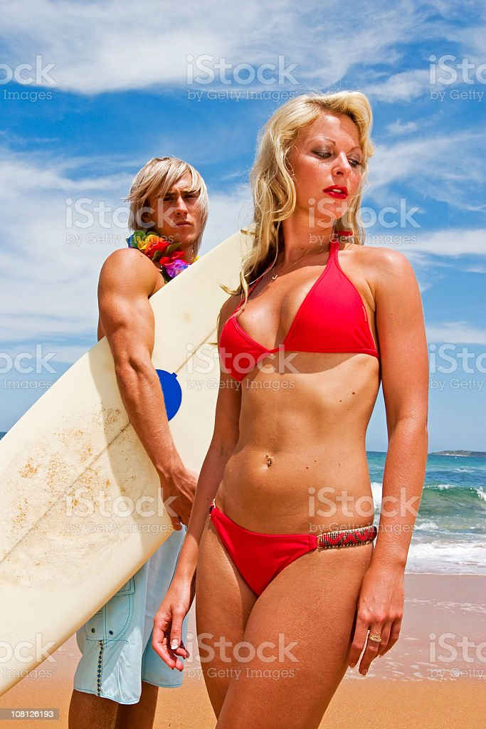 Surfer Man and Woman on Beach royalty-free stock photo