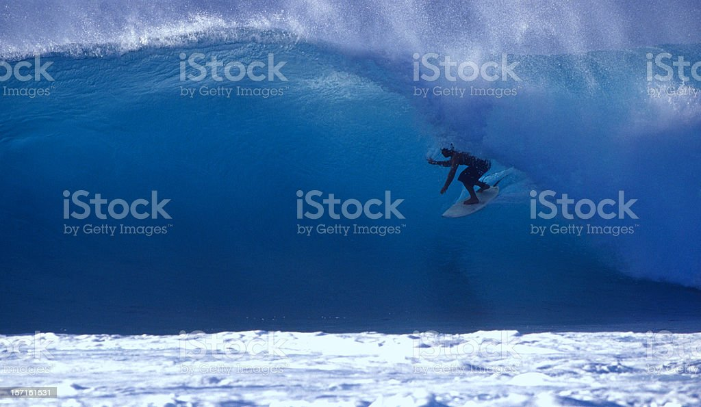 surfer on a blue wave stock photo