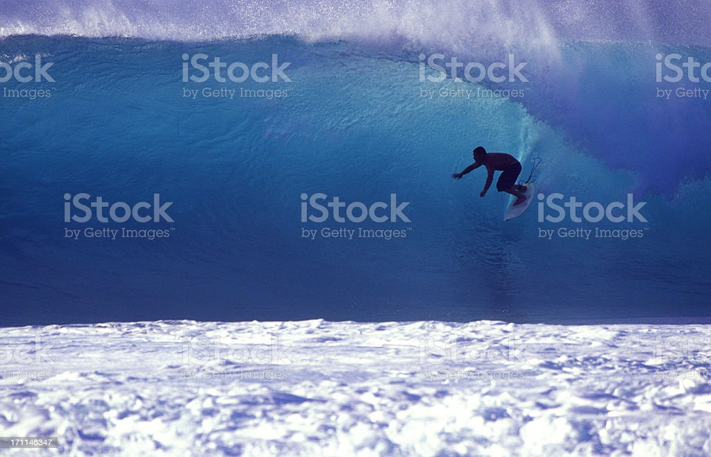 surfer on a blue wave royalty-free stock photo