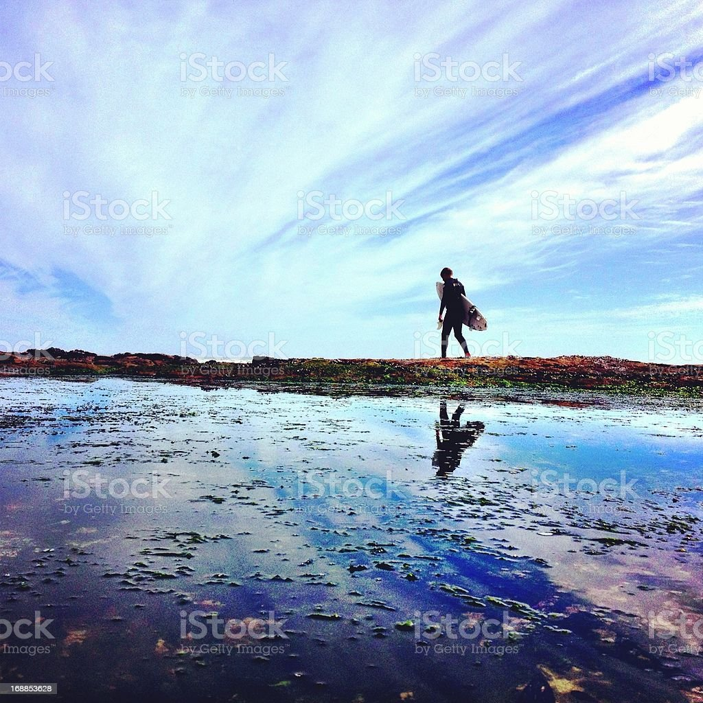 Surfer on his way to waves royalty-free stock photo