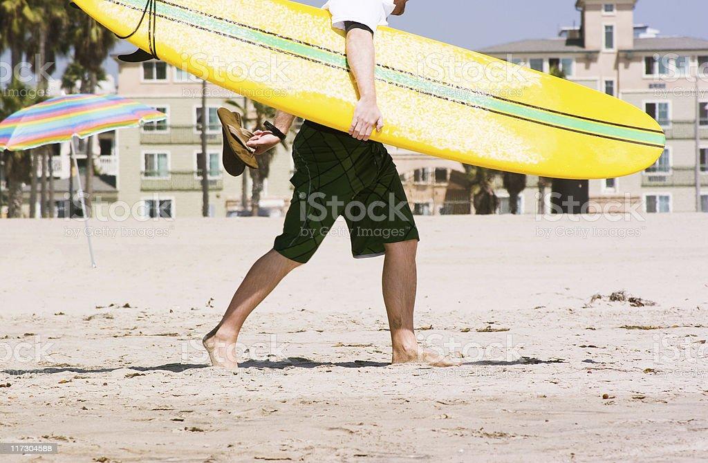 Surfer on the beach stock photo