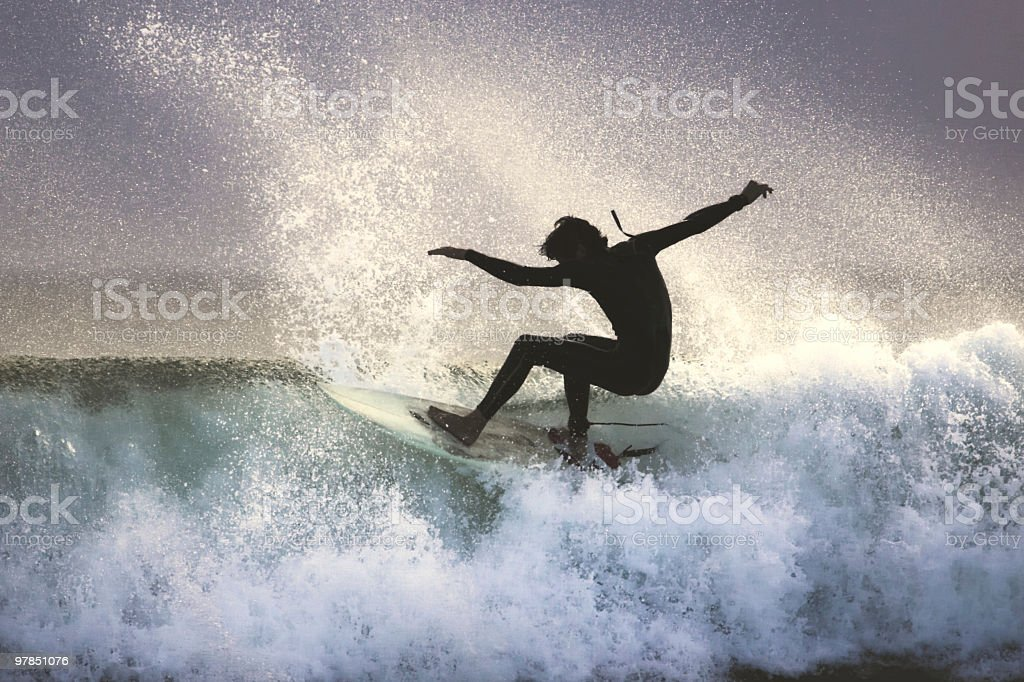 Surfer on the Lip of a Wave stock photo