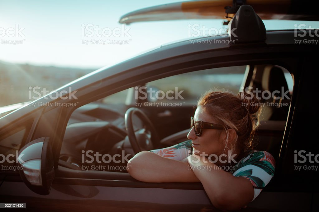 Surfer on the summer road trip stock photo