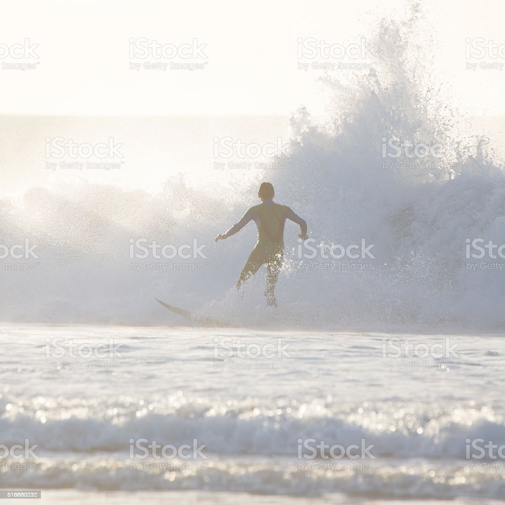 Surfer riding a big wave. stock photo