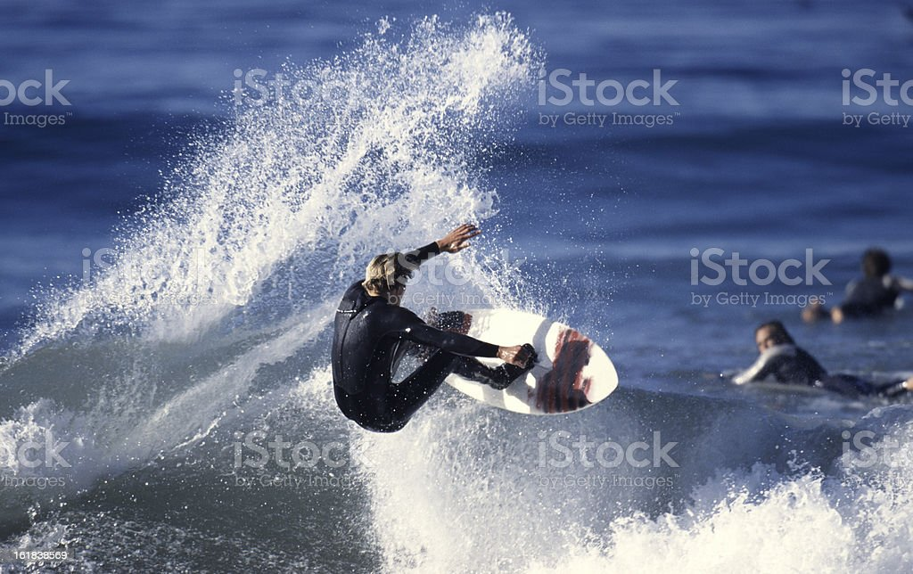 A surfer riding a wave in the ocean stock photo