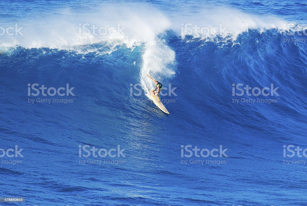 Surfer riding giant wave stock photo
