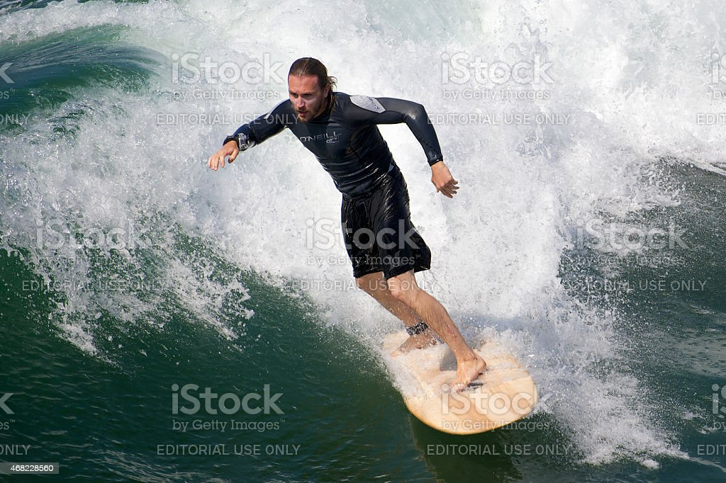 Surfer riding the wave on Venice Beach, California stock photo