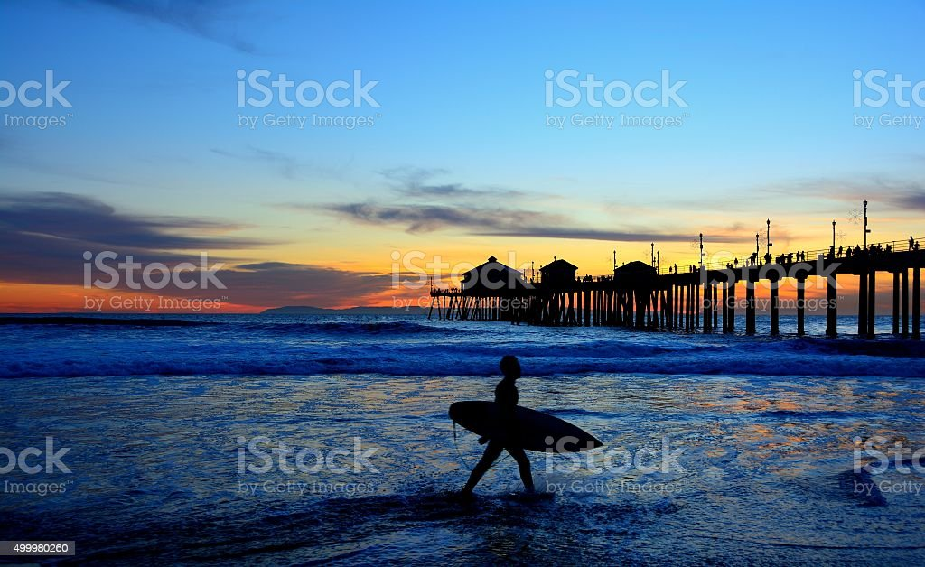 Surfer Silhouette at Dusk stock photo