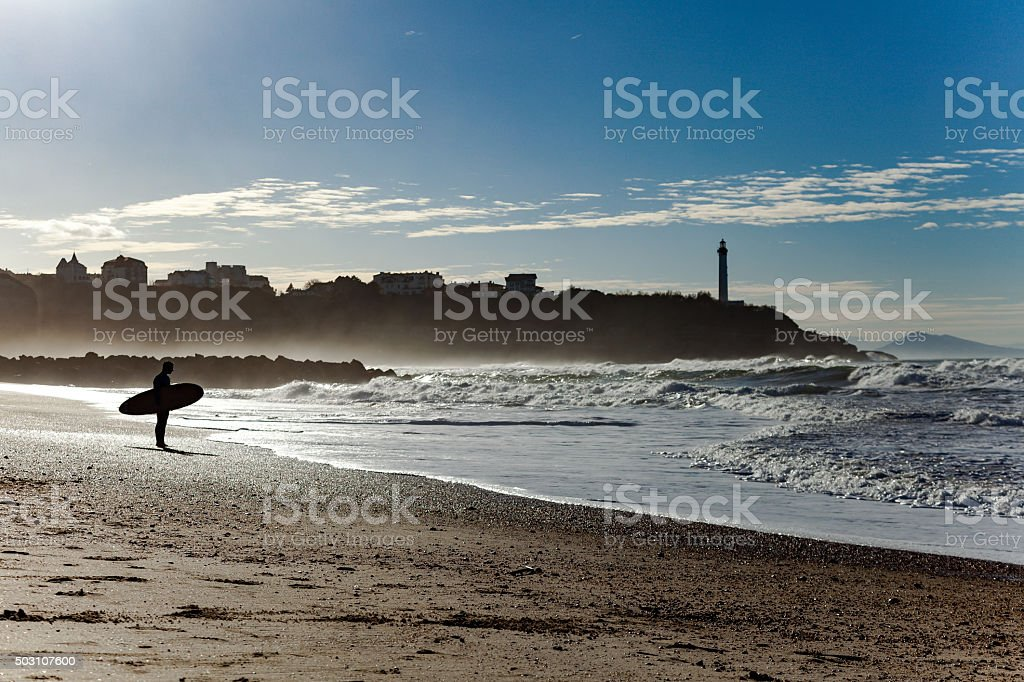 Surfer silhouette in front of the Ocean stock photo
