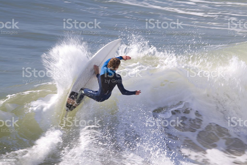 surfer smacking the wave royalty-free stock photo