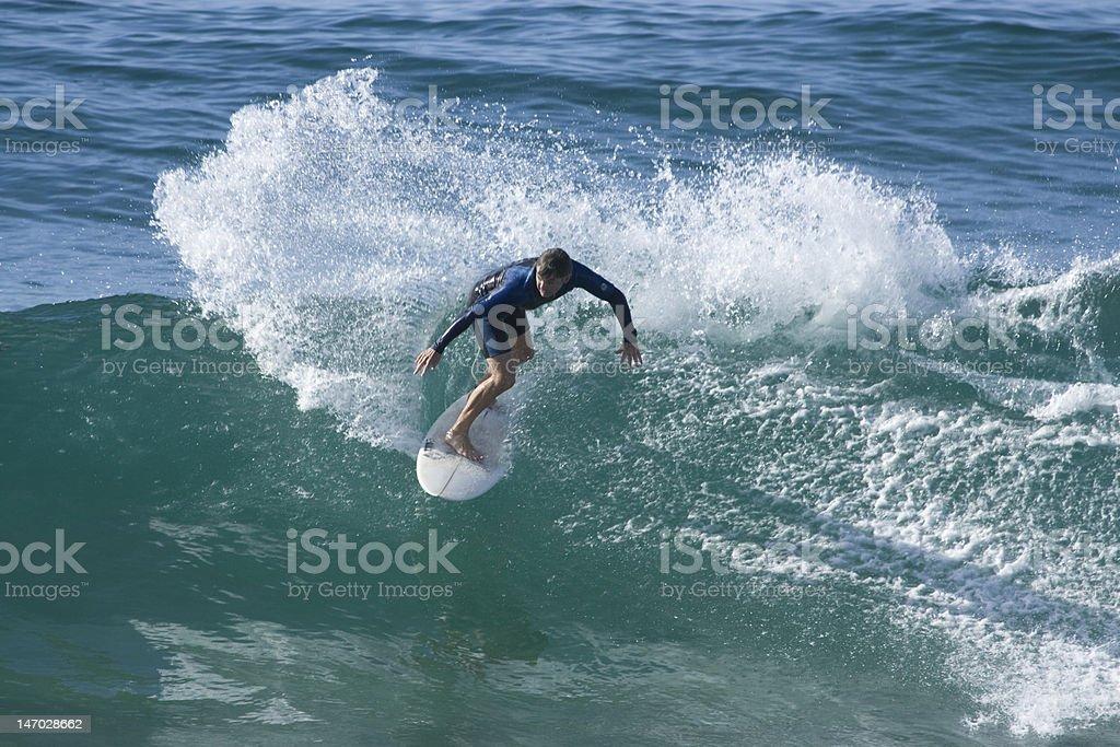 Surfer Sprays Wave stock photo