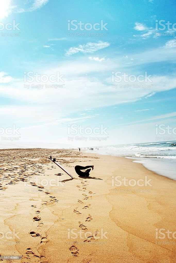Surfer Stretching on the Beach royalty-free stock photo