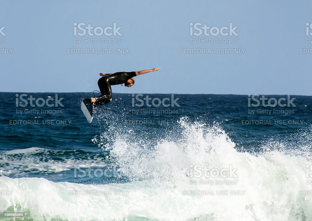Surfer surfing at Tamarama beach stock photo