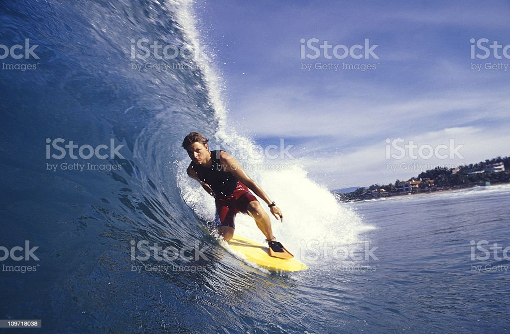 A surfer surfing in the sea in a high wave loving it stock photo