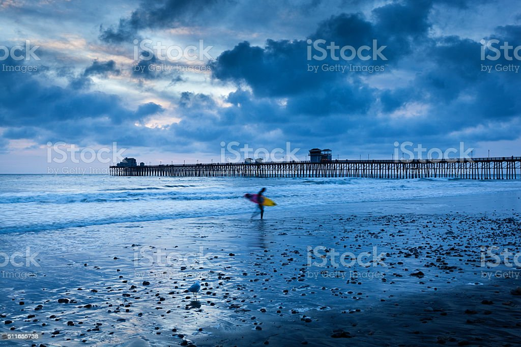 Surfer Surfing on the Beach of Oceanside California stock photo
