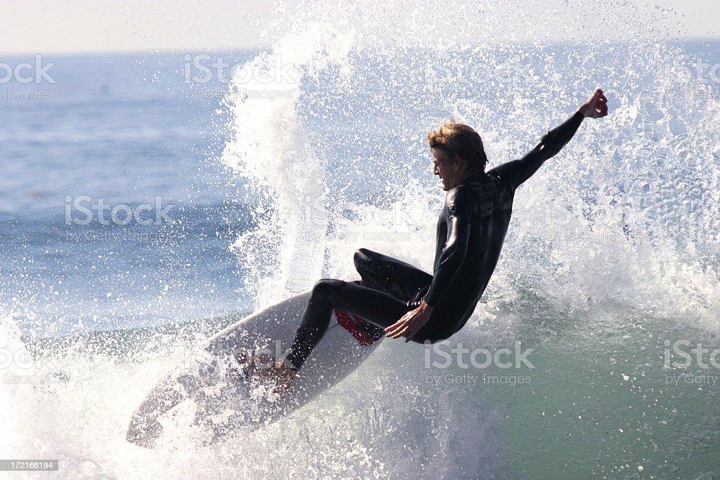 Surfer throwing big spray royalty-free stock photo