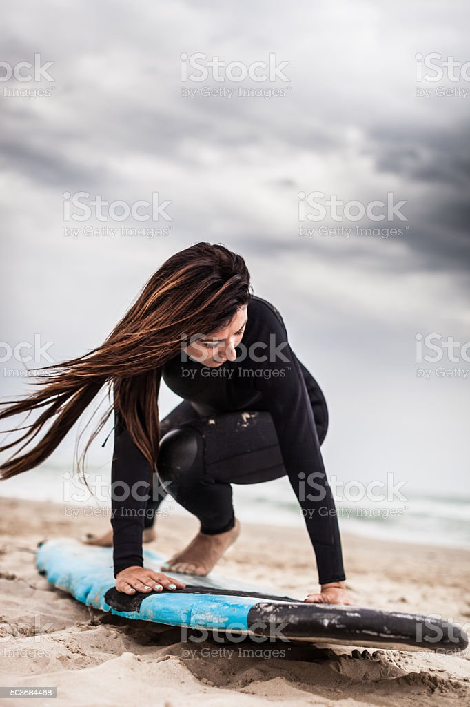 Surfer training before jumping into the water stock photo