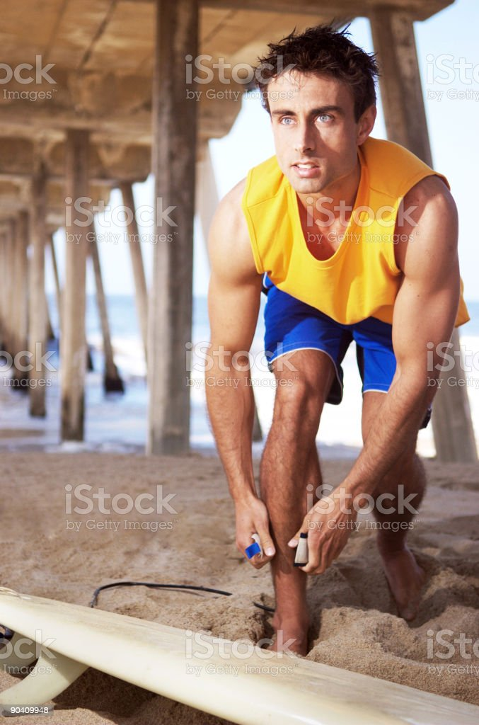 Surfer Under PIer royalty-free stock photo