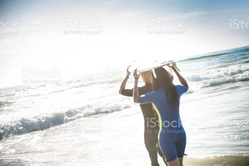 surfer watching the sunset in manhattan beach in los angeles stock photo