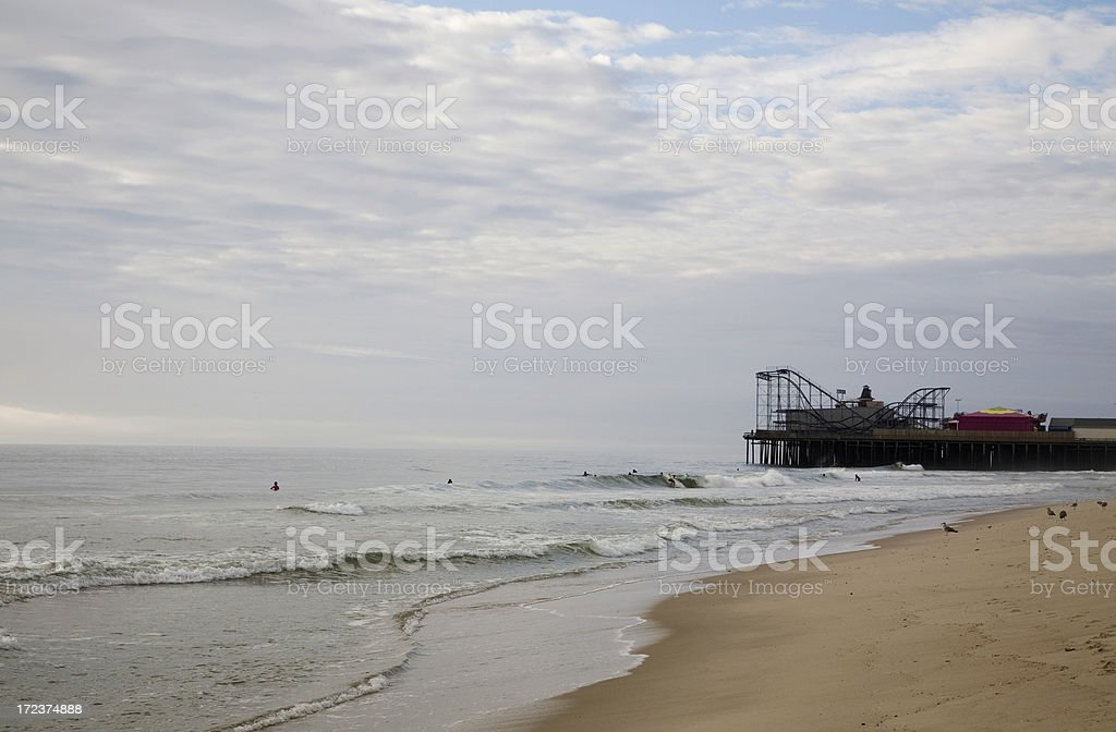 Surfers and Amusements in the Distance royalty-free stock photo