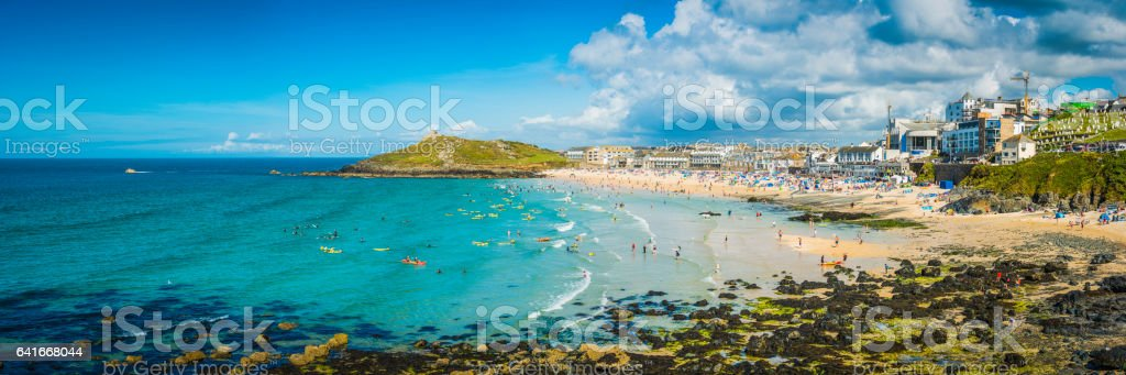 Surfers and sunbathers on sandy beach St Ives panorama Cornwall stock photo