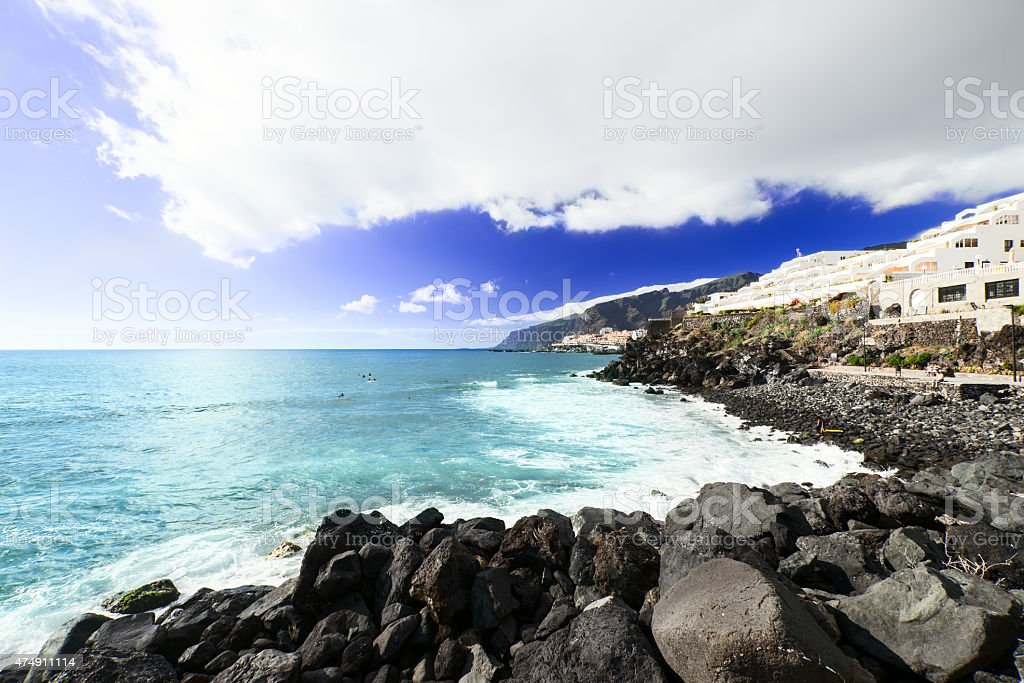 Surfers at beach at Tenerife Island Spain far view stock photo