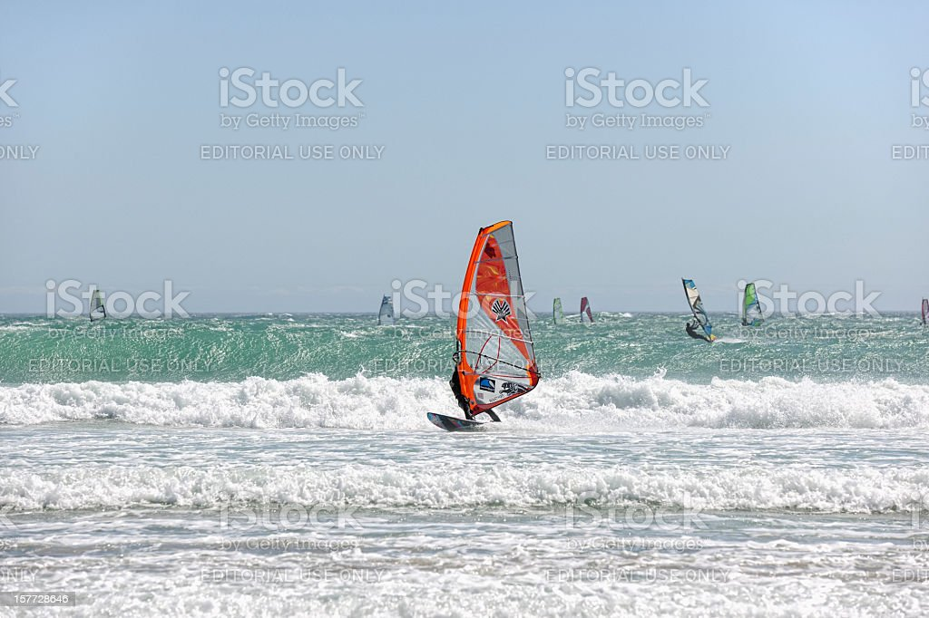 Surfers at Big Bay Cape Town stock photo