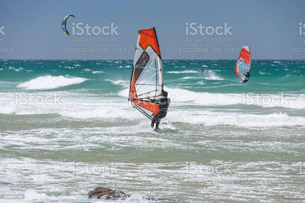 Surfers at Guincho Beach near Cascais in Portugal stock photo