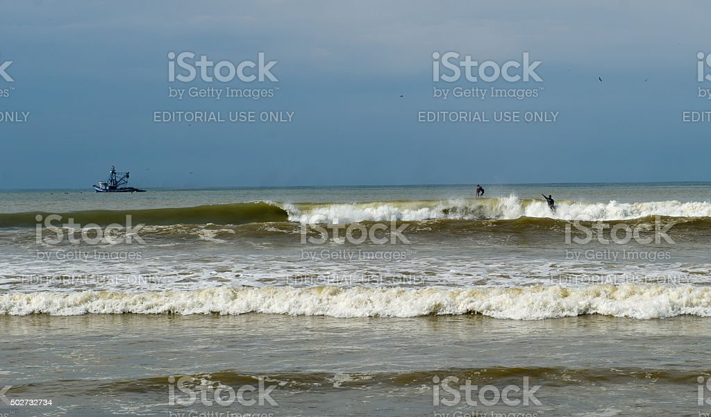 Surfers at Playa Dominical, Costa Rica stock photo