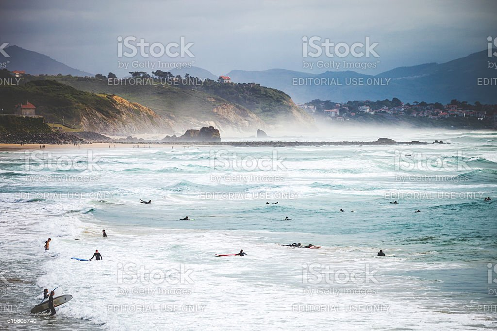 Surfers at the beach. Biarritz, France. stock photo