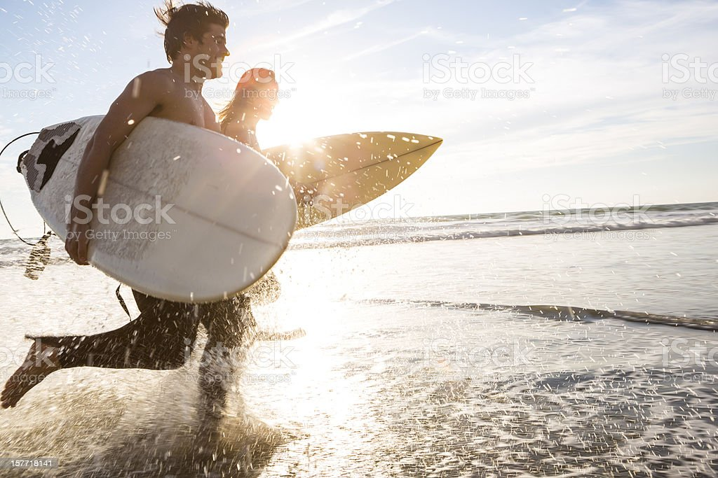 Surfers at the beach royalty-free stock photo