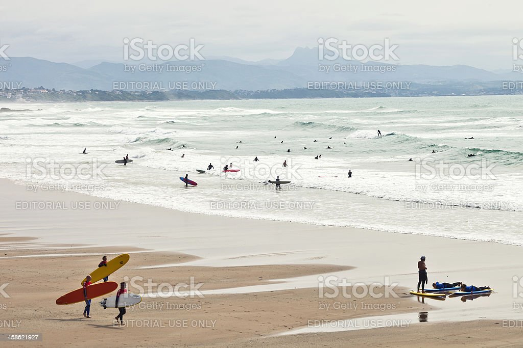 Surfers at the beach stock photo