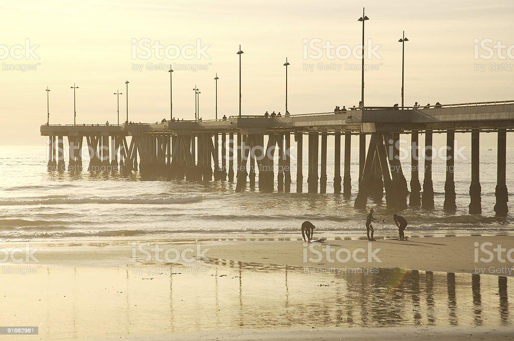 Surfers at Venice pier stock photo